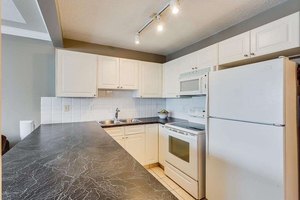 Photo 7: Photos: 137 MILLVIEW Square SW in Calgary: Millrise House for sale : MLS®# C4145951