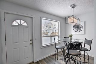 Photo 15: 148 Sandpiper Lane NW in Calgary: Sandstone Valley Row/Townhouse for sale : MLS®# A1085930