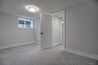 Photo 27: 428 Queensland Place SE in Calgary: Queensland Detached for sale : MLS®# A1123747