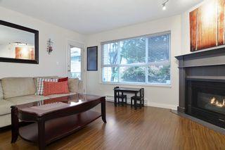 "Photo 4: 105 20200 54A Avenue in Langley: Langley City Condo for sale in ""MONTEREY GRANDE"" : MLS®# F1438210"