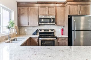 Photo 6: 617 HILLCREST Road SW: Airdrie Row/Townhouse for sale : MLS®# C4306050