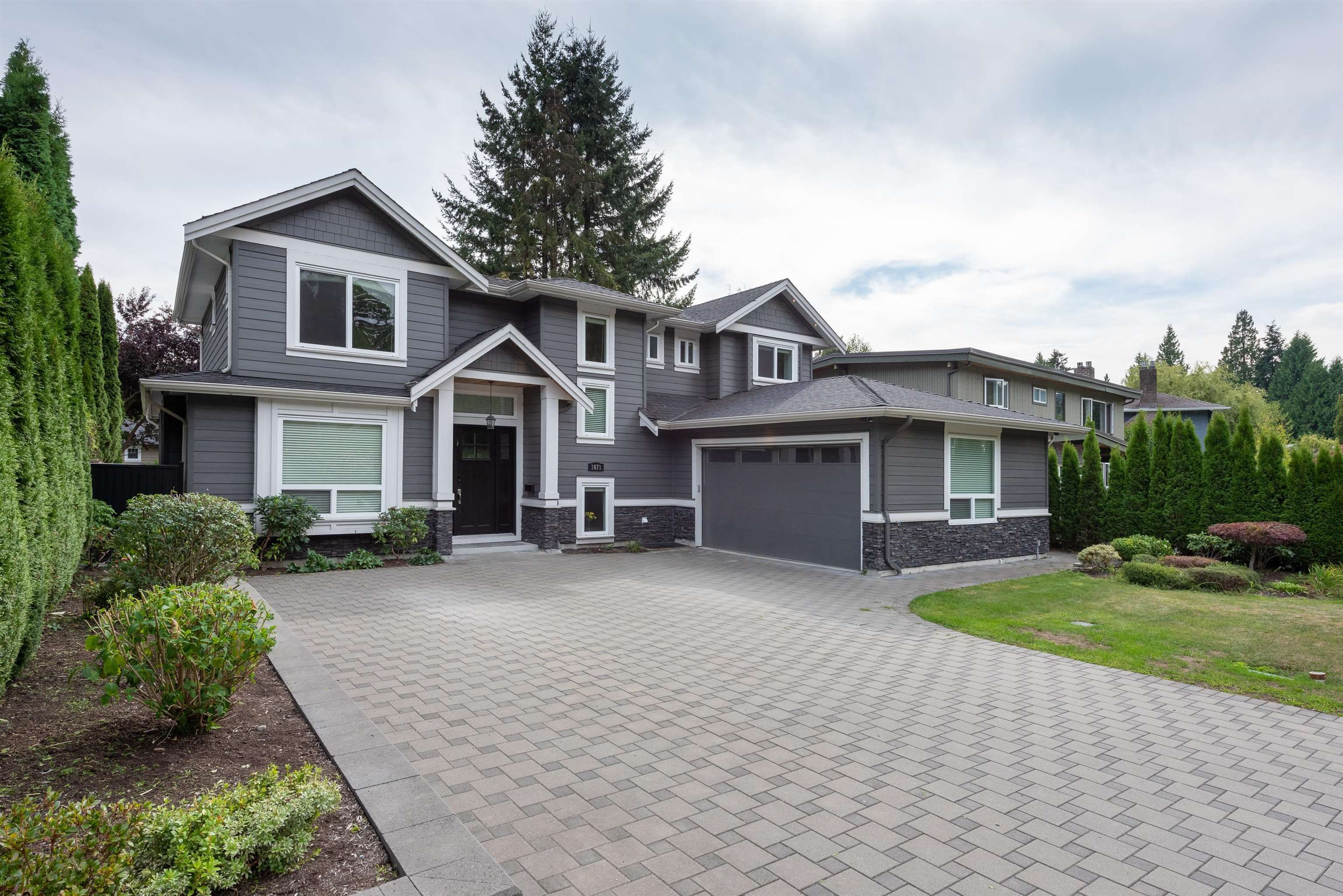 Main Photo: 1671 PIERARD Road in North Vancouver: Lynn Valley House for sale : MLS®# R2617072
