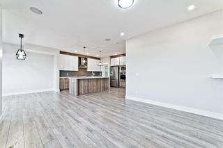Photo 14: 110 Creekside Way SW in Calgary: C-168 Detached for sale : MLS®# A1144318