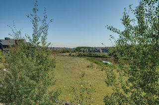 Photo 9: 111 Ascot Point SW in Calgary: Aspen Woods Row/Townhouse for sale : MLS®# A1144877