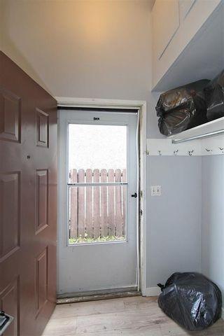 Photo 2: 128 FALCONRIDGE Crescent NE in Calgary: Falconridge Semi Detached for sale : MLS®# C4302910