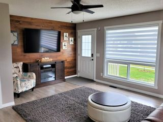 Photo 14: 1404 Clover Link: Carstairs Row/Townhouse for sale : MLS®# A1073804