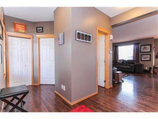 Photo 4: 381 ELGIN Way SE in Calgary: McKenzie Towne House for sale : MLS®# C4036653