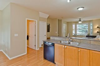 Photo 12: 205 2006 LUXSTONE Boulevard SW: Airdrie Row/Townhouse for sale : MLS®# A1010440
