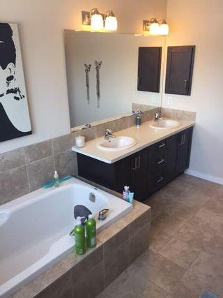 Photo 15: 18 Mount Rae Ridge: Okotoks House for sale : MLS®# C4144821