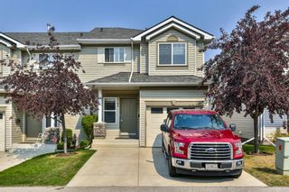 Photo 1: 93 Rocky Vista Circle NW in Calgary: Rocky Ridge Row/Townhouse for sale : MLS®# A1071802