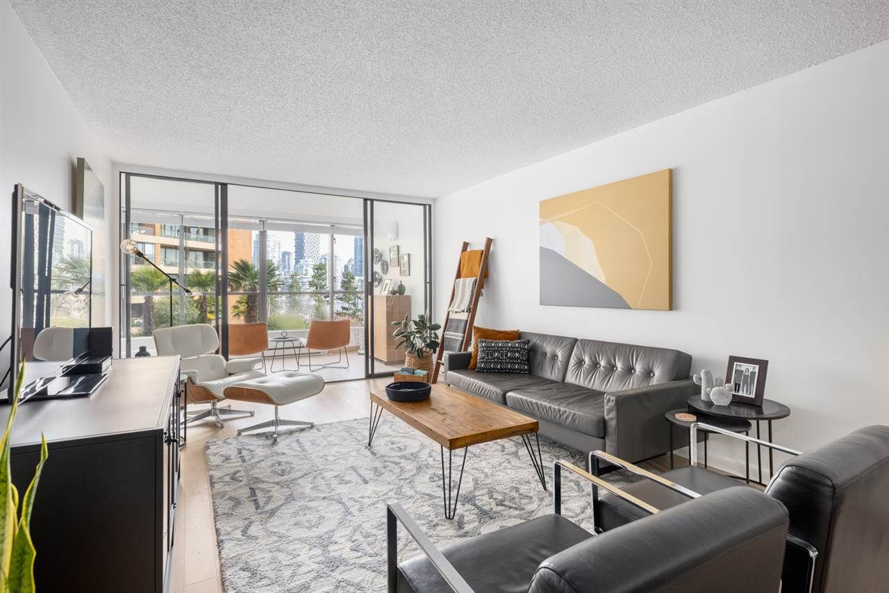 """Photo 1: Photos: 307 1470 PENNYFARTHING Drive in Vancouver: False Creek Condo for sale in """"Harbour Cove"""" (Vancouver West)  : MLS®# R2552898"""
