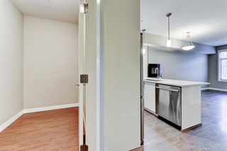 Photo 4: 211 28 Auburn Bay Link SE in Calgary: Auburn Bay Apartment for sale : MLS®# A1076356