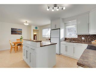 Photo 6: 803 104 Avenue SW in Calgary: Southwood House for sale : MLS®# C4092868