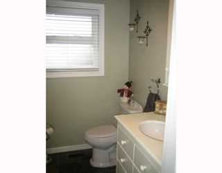 Photo 7: 1833 SALISBURY Avenue in Port Coquitlam: Glenwood PQ House for sale : MLS®# V799044