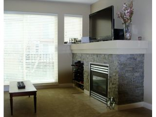 """Photo 3: 32 1561 BOOTH Avenue in Coquitlam: Maillardville Townhouse for sale in """"THE COURCELLES"""" : MLS®# V942779"""