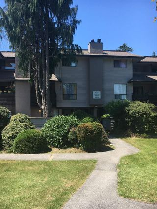 """Photo 1: 14852 HOLLY PARK Lane in Surrey: Guildford Townhouse for sale in """"Holly Park Lane"""" (North Surrey)  : MLS®# R2281811"""