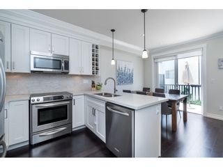 """Photo 6: 8 16458 23A Avenue in Surrey: Grandview Surrey Townhouse for sale in """"Essence at the Hamptons"""" (South Surrey White Rock)  : MLS®# R2380540"""