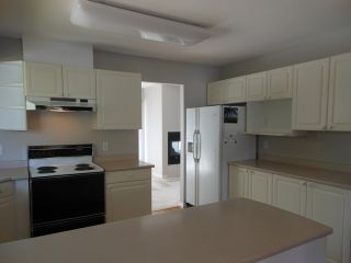 """Photo 3: 124 16080 82ND Avenue in Surrey: Fleetwood Tynehead Townhouse for sale in """"Ponderosa Estates"""" : MLS®# F1321774"""