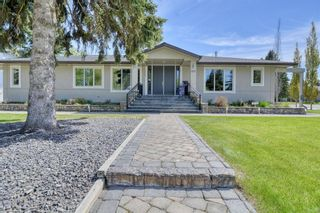 Main Photo: 1001 70 Avenue SW in Calgary: Kelvin Grove Detached for sale : MLS®# A1115392