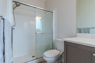 Photo 27: 145 Shawnee Common SW in Calgary: Shawnee Slopes Row/Townhouse for sale : MLS®# A1097036