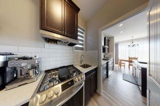 Photo 11: 18 Carrington Road NW in Calgary: Carrington Detached for sale : MLS®# A1149582