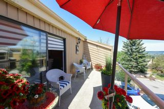 Photo 25: 18 1220 Prominence Way SW in Calgary: Patterson Row/Townhouse for sale : MLS®# A1133893