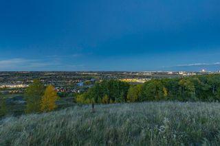 Photo 35: 40 Cougar Ridge Landing SW in Calgary: Cougar Ridge Row/Townhouse for sale : MLS®# A1148928