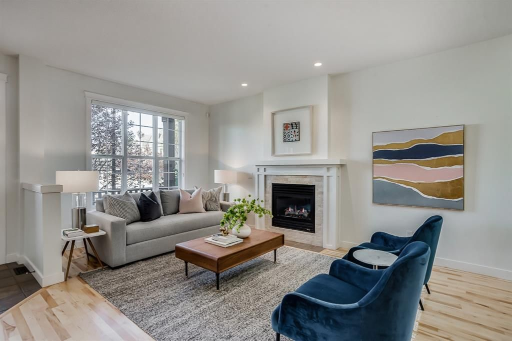 Photo 3: Photos: 219 Somme Manor SW in Calgary: Garrison Woods Detached for sale : MLS®# A1041747
