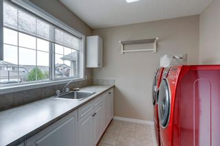 Photo 20: 63 Springbluff Boulevard SW in Calgary: Springbank Hill Detached for sale : MLS®# A1131940