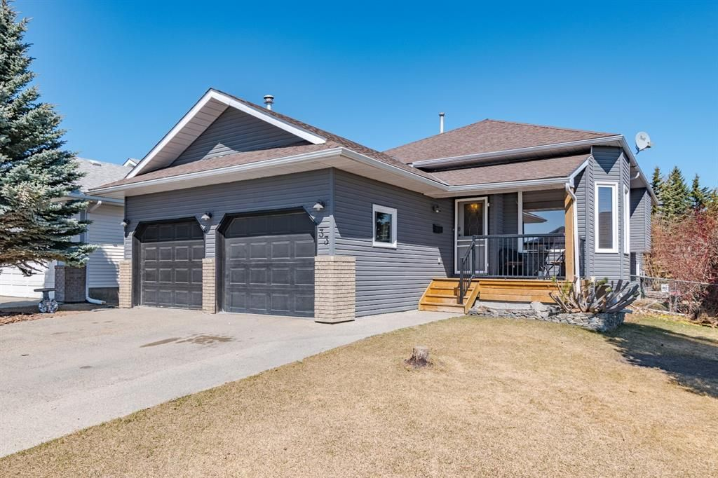 Main Photo: 33 Riverview Close: Cochrane Detached for sale : MLS®# A1094646