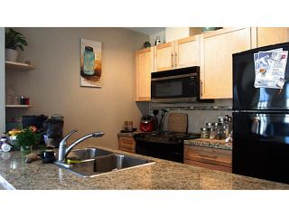 """Photo 6: 411 1211 VILLAGE GREEN Way in Squamish: Downtown SQ Condo for sale in """"ROCKCLIFFE"""" : MLS®# V1097477"""