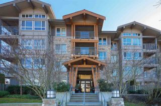 "Main Photo: 104 3132 DAYANEE SPRINGS Boulevard in Coquitlam: Westwood Plateau Condo for sale in ""LEDGEVIEW"" : MLS®# R2571593"