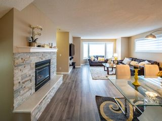 Main Photo: 27 Sandarac Road NW in Calgary: Sandstone Valley Row/Townhouse for sale : MLS®# A1148451