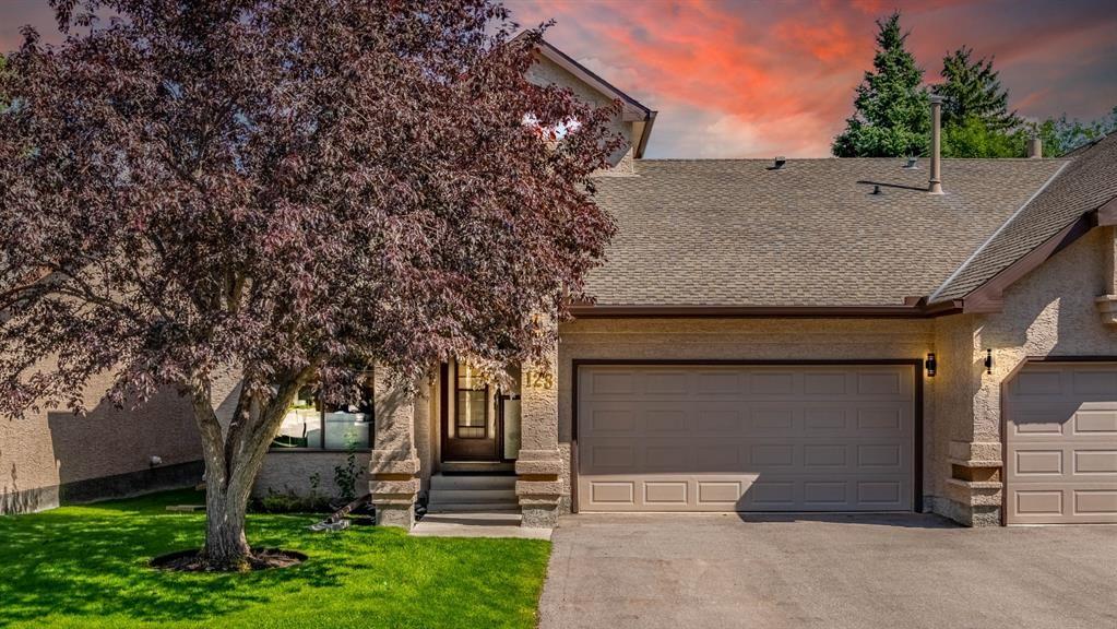 Main Photo: 128 Oakbriar Close SW in Calgary: Palliser Semi Detached for sale : MLS®# A1141127
