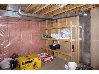 Photo 25: 208 TARINGTON Close NE in Calgary: Taradale House for sale : MLS®# C4040082