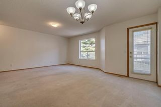 Photo 3: 40 Mt Aberdeen Manor SE in Calgary: McKenzie Lake Row/Townhouse for sale : MLS®# A1100285