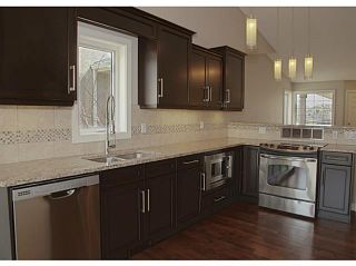 Photo 2: 130 RIVERSIDE Crescent NW: High River Residential Attached for sale : MLS®# C3612435