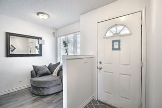 Photo 4: 154 388 Sandarac Drive NW in Calgary: Sandstone Valley Row/Townhouse for sale : MLS®# A1115422
