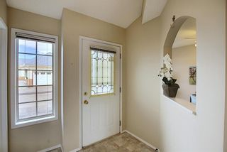 Photo 1: 8 12 Woodside Rise NW: Airdrie Row/Townhouse for sale : MLS®# A1108776