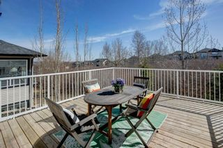 Photo 8: 102 Crestbrook Hill SW in Calgary: Crestmont Detached for sale : MLS®# A1100140