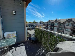 """Photo 33: 407 19936 56 Avenue in Langley: Langley City Condo for sale in """"Bearing Pointe"""" : MLS®# R2616051"""