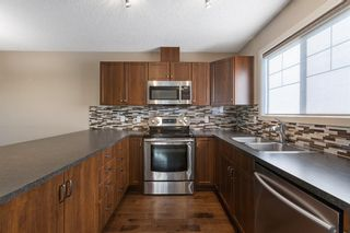 Photo 12: 122 Sunset Road: Cochrane Row/Townhouse for sale : MLS®# A1127717