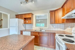 Photo 16: 66 Crystal Shores Cove: Okotoks Row/Townhouse for sale : MLS®# C4305435