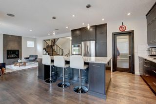 Photo 1: 127 Springbluff Boulevard SW in Calgary: Springbank Hill Detached for sale : MLS®# A1140601