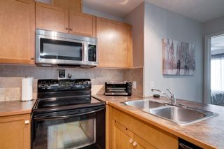 Photo 5: 1302 92 Crystal Shores Road: Okotoks Apartment for sale : MLS®# A1132113