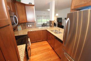 Photo 15: 2101 4 Kingsland Close SE: Airdrie Apartment for sale : MLS®# A1117201