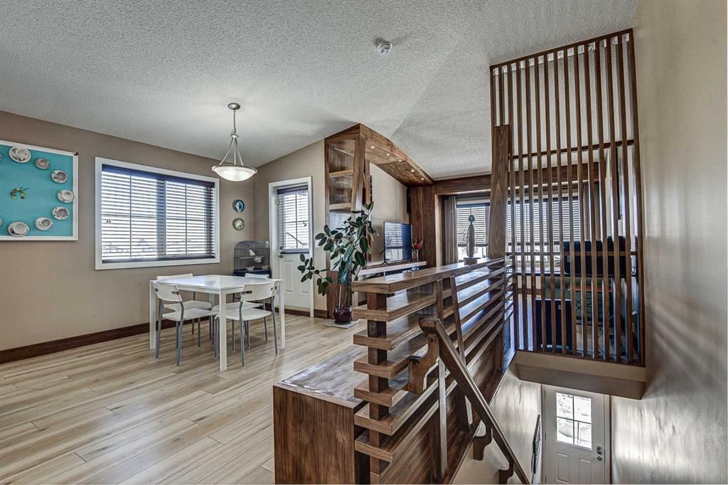 Main Photo: 230 EVERSYDE Boulevard SW in Calgary: Evergreen Apartment for sale : MLS®# A1071129