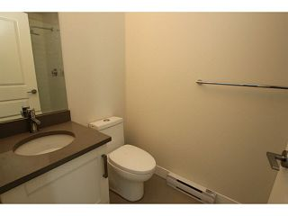 """Photo 12: 101 218 BEGIN Street in Coquitlam: Maillardville House for sale in """"BEGIN SQUARE"""" : MLS®# V1132326"""