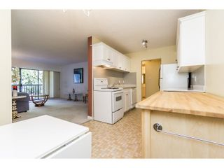 "Photo 7: 210 150 E 5TH Street in North Vancouver: Lower Lonsdale Condo for sale in ""NORMANDY HOUSE"" : MLS®# R2051568"