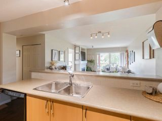 """Photo 8: 408 200 KLAHANIE Drive in Port Moody: Port Moody Centre Condo for sale in """"Salal"""" : MLS®# R2603495"""